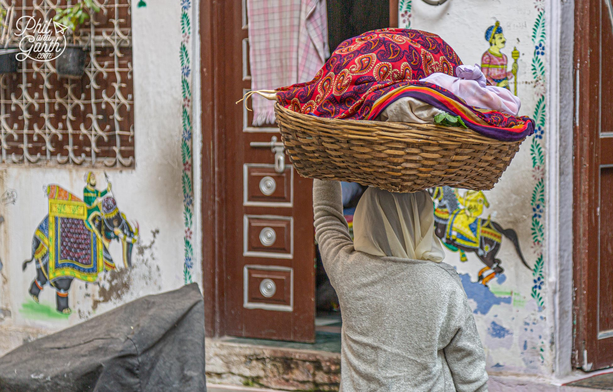 A lady transports her laundry