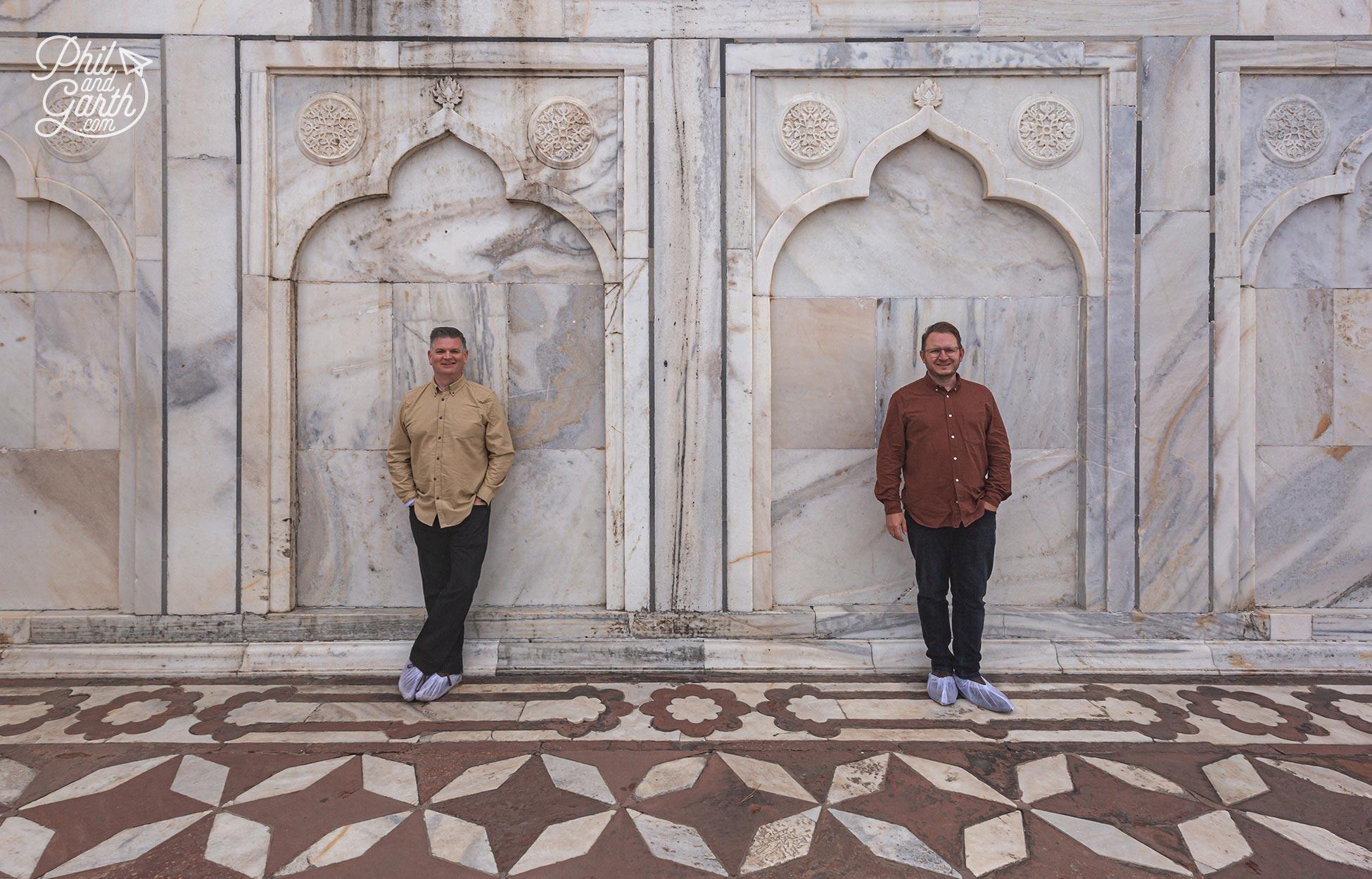 Phil and Garth stood next to a wall of the Taj Mahal