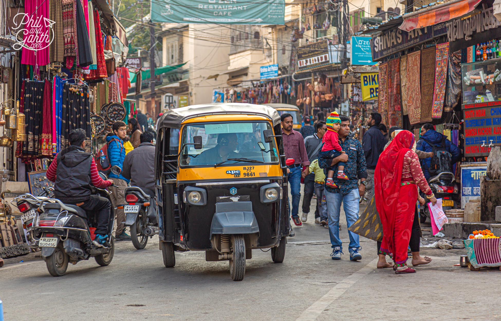 Tuk tuks vary in size by cities in India. In Udaipur they are bigger and can seat 3 people