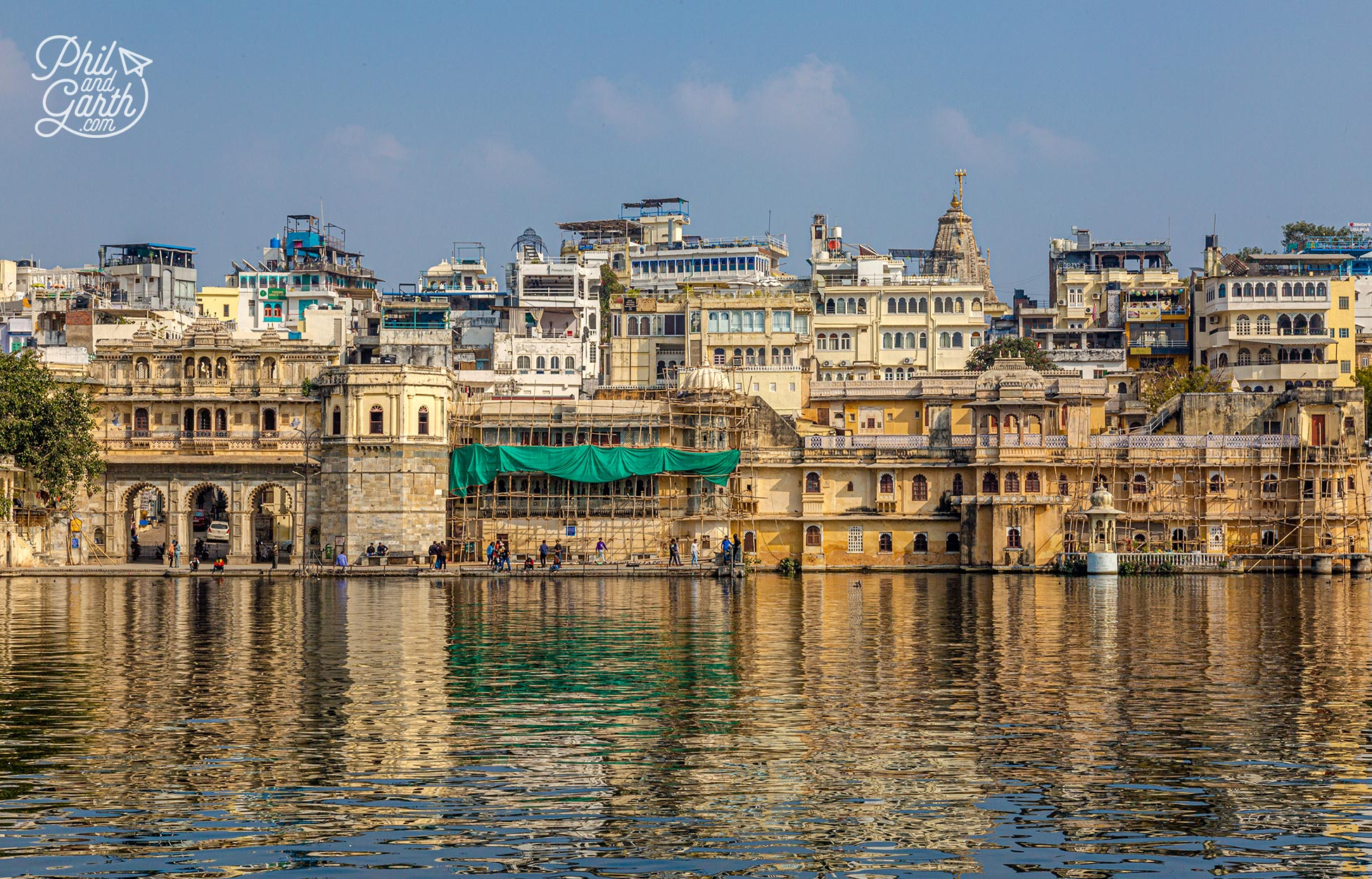 View of Gangaur Ghat with shimmering reflections in the lake