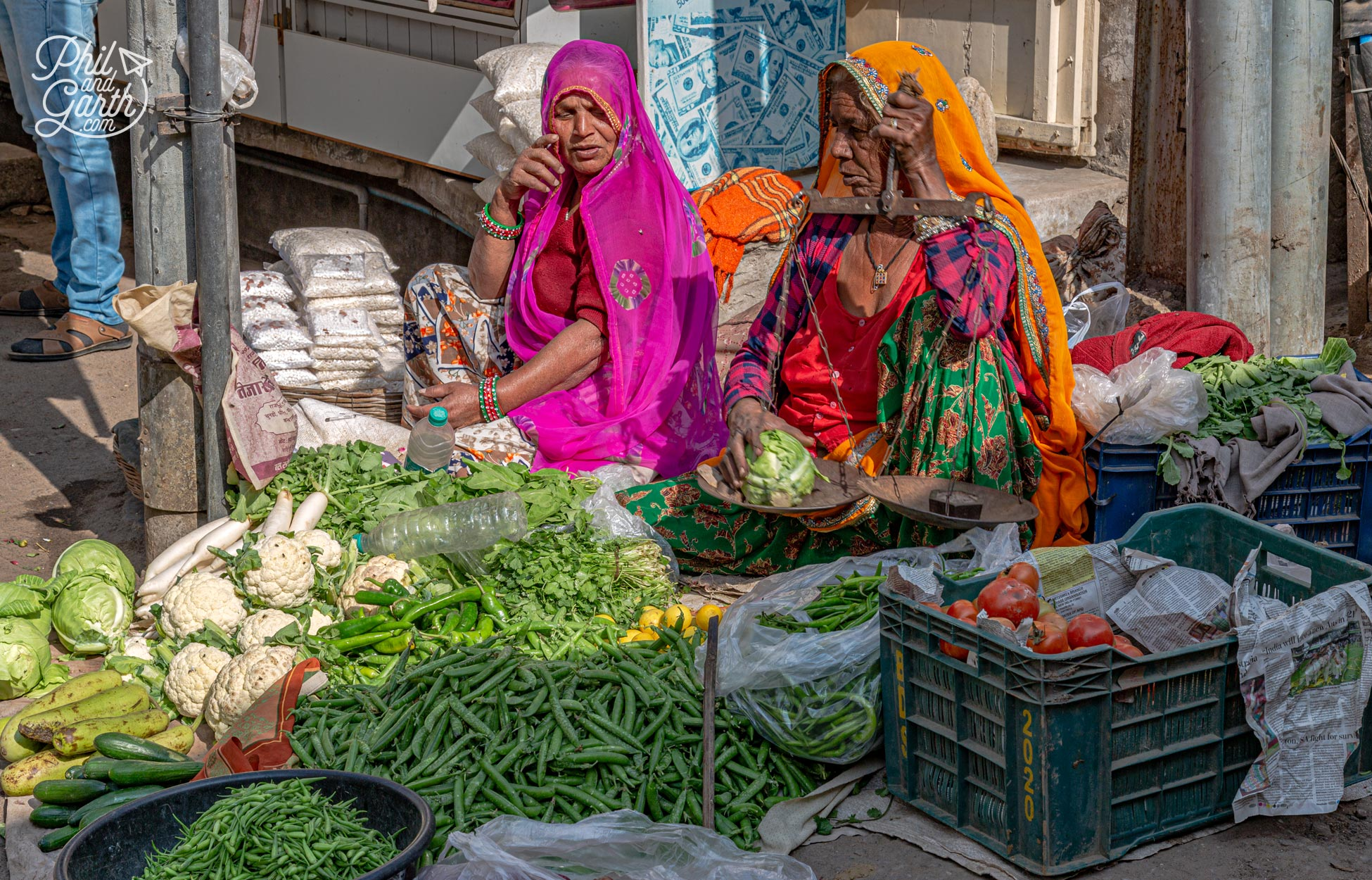 A couple more ladies selling vegetables on a street corner