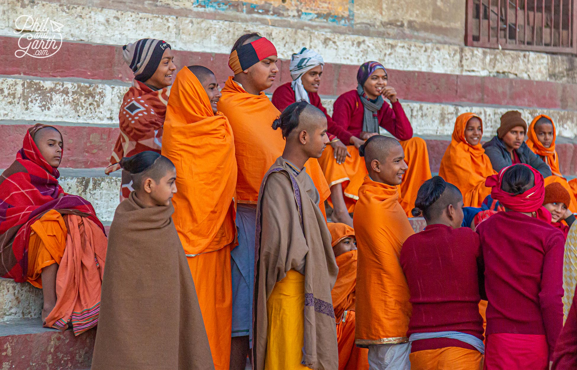 A group of young monks prepare to bathe