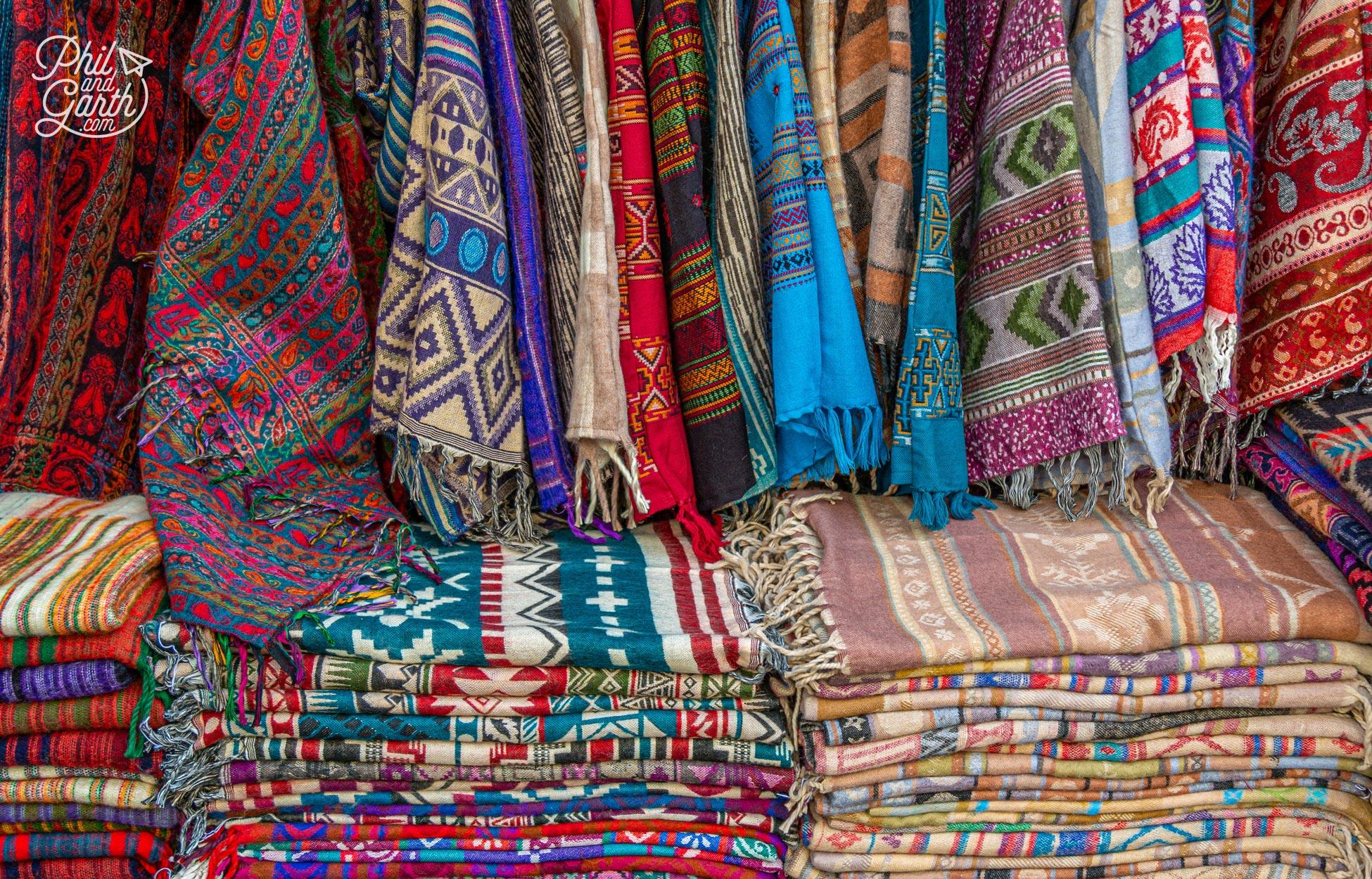 Colourful pashminas for sale in a Pushkar bazaar