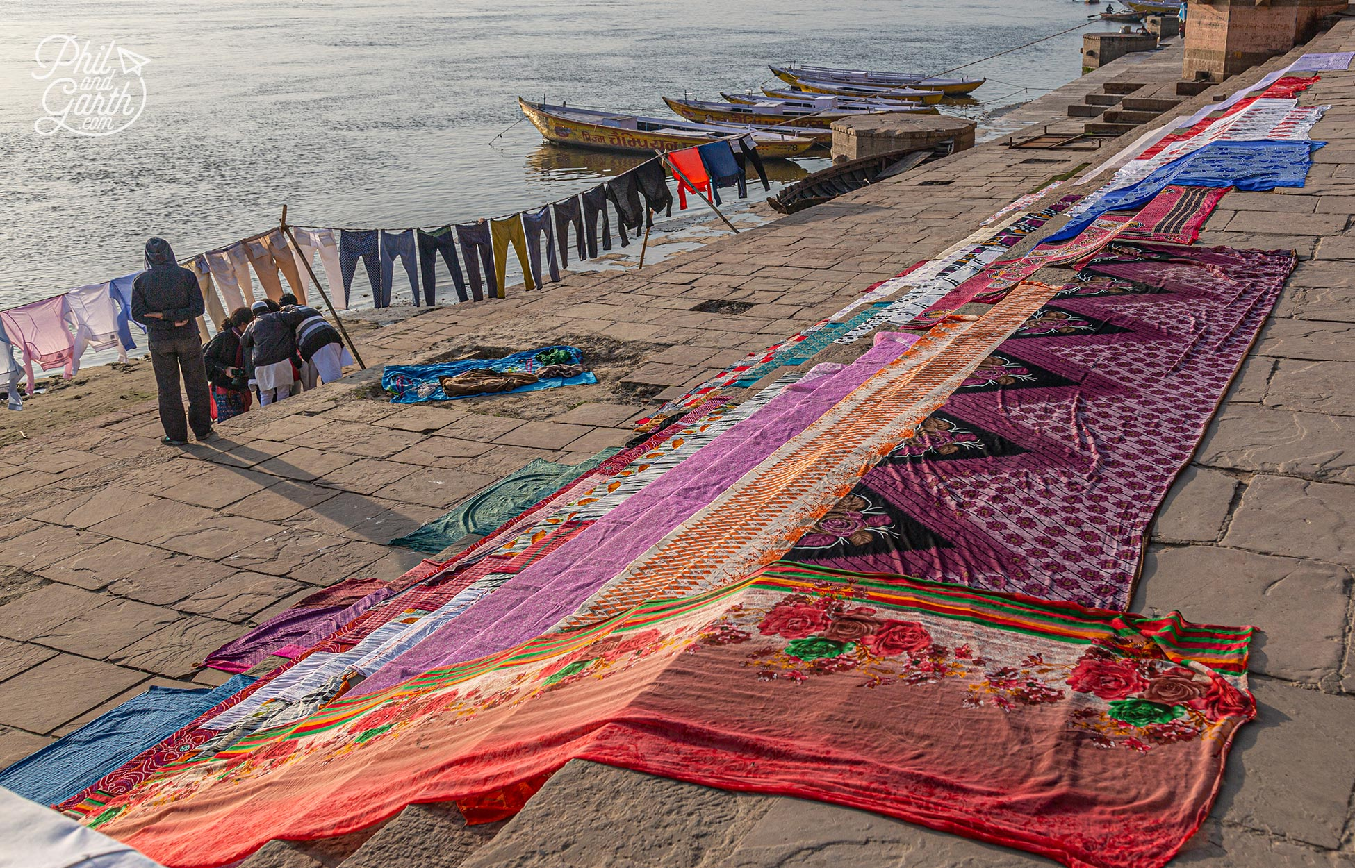 Colourful saris laid out to dry on the ghats