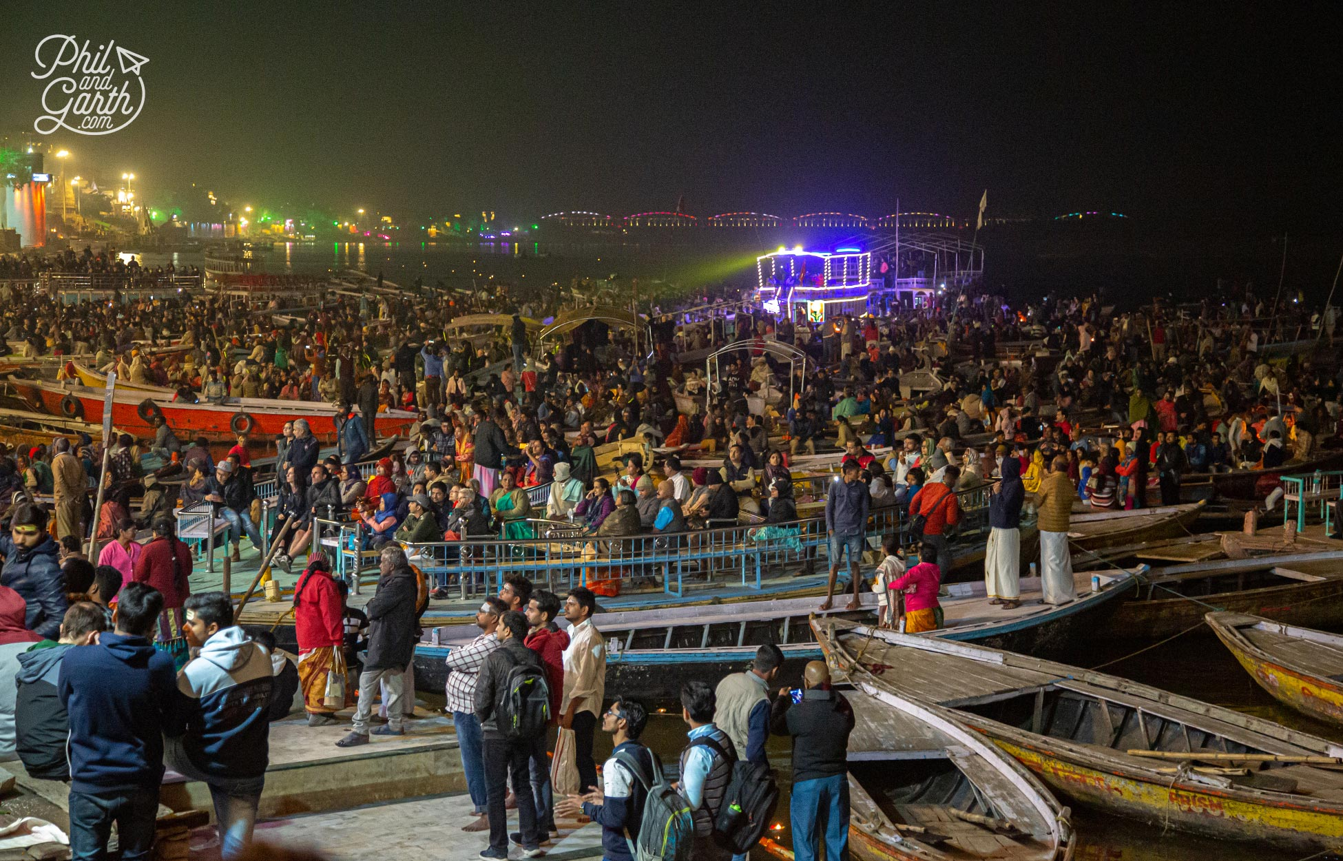 Hundreds of people watching the Aarti from the river