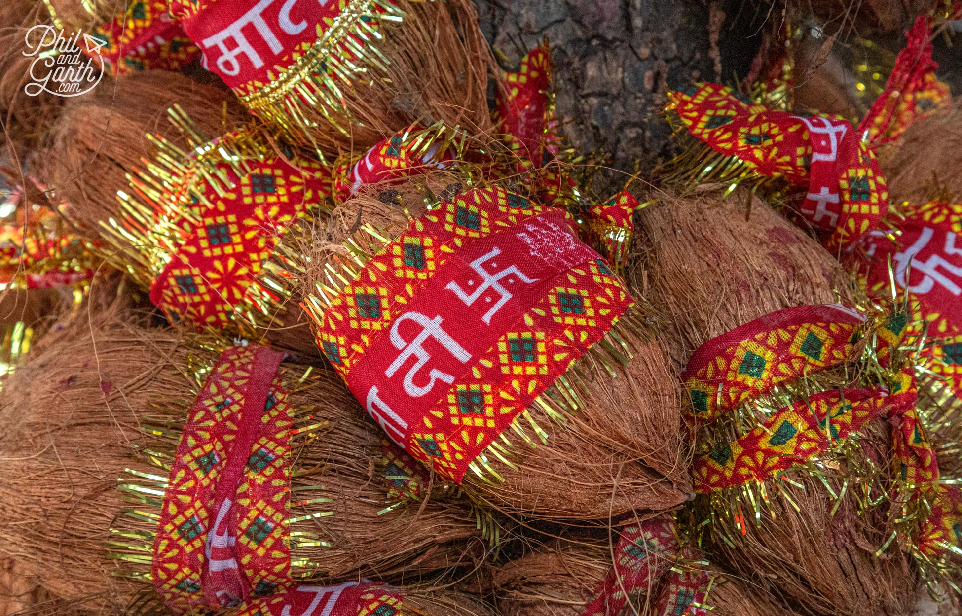 In Hinduism coconuts symbolise God. Whilst the swastika has been a sacred symbol for millions of years