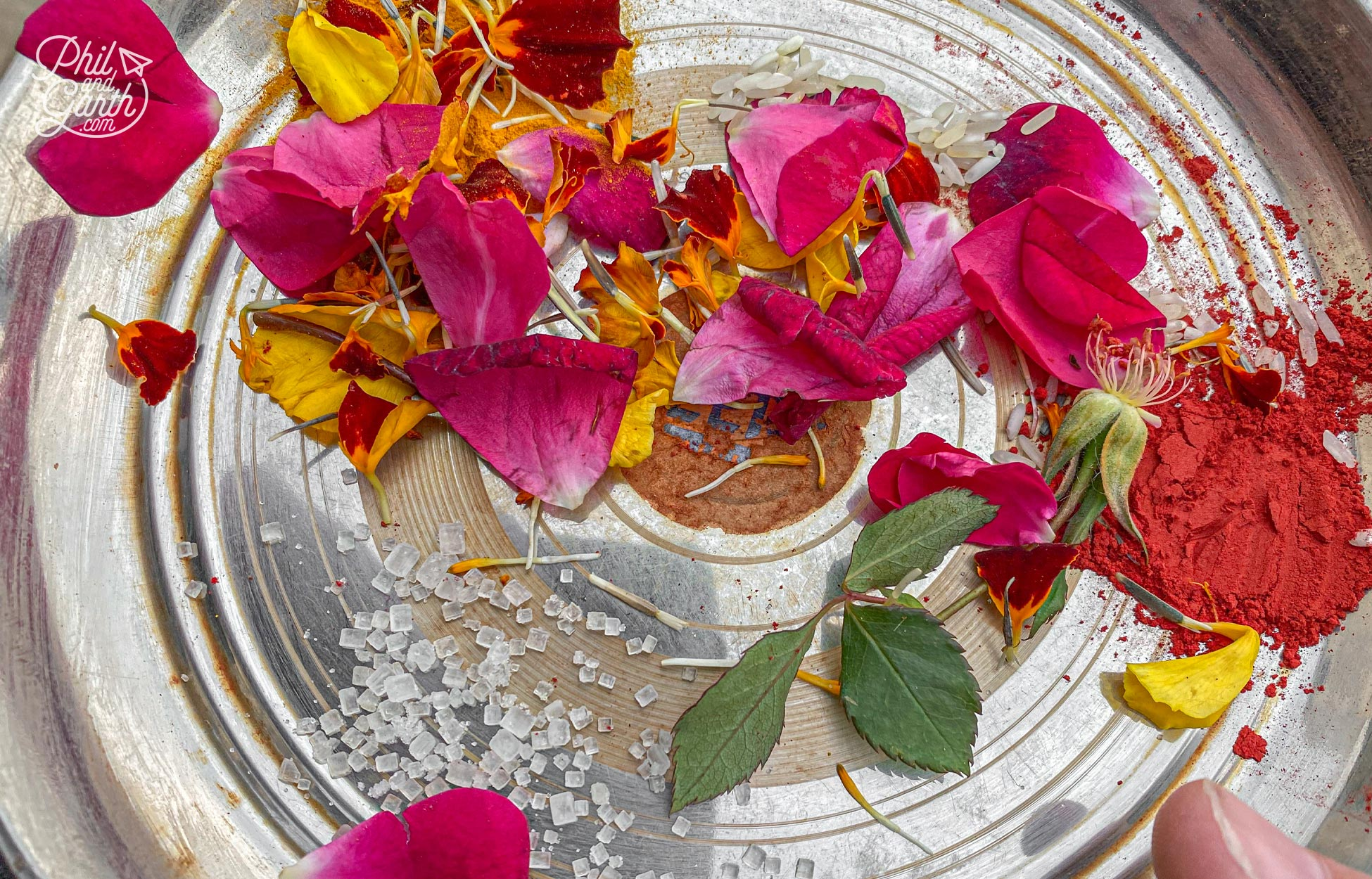 Our tray of offerings included rice grains, spices and rose petals