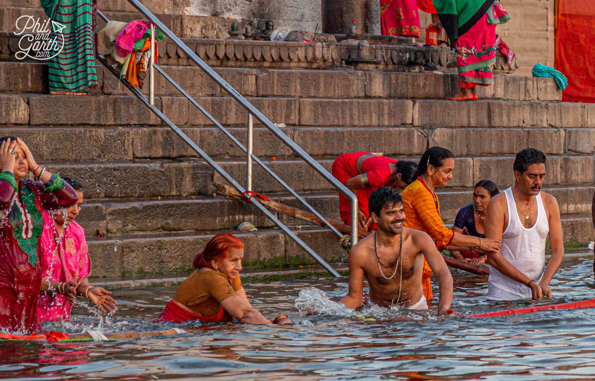 People bathing early morning in the River Ganges. The holy river is personfied as the Goddess Ganga