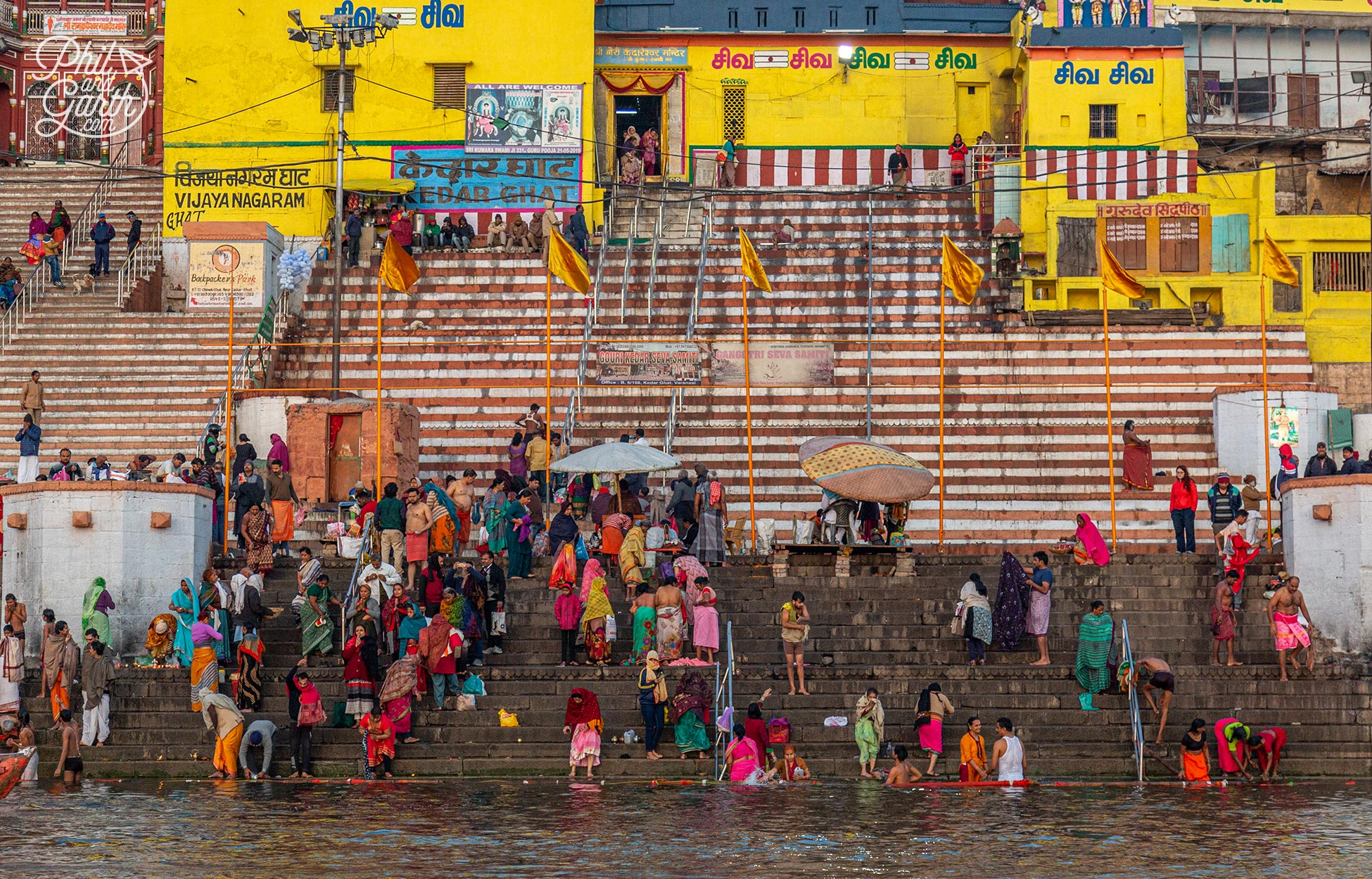 People take dips in the holy water of the River Ganges to wash away sins