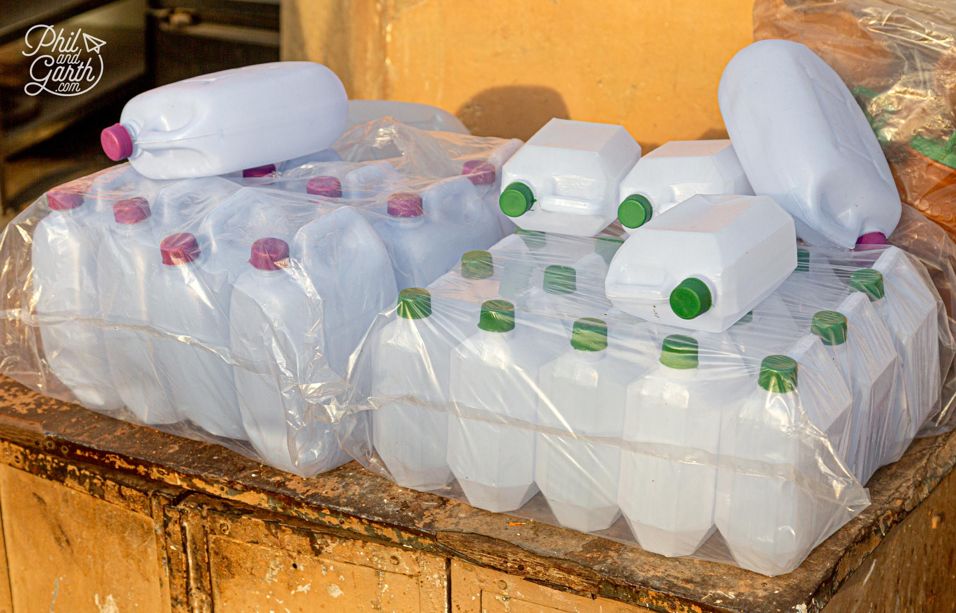 Plastic bottles for sale - so people can take home some holy water from the River Ganges.