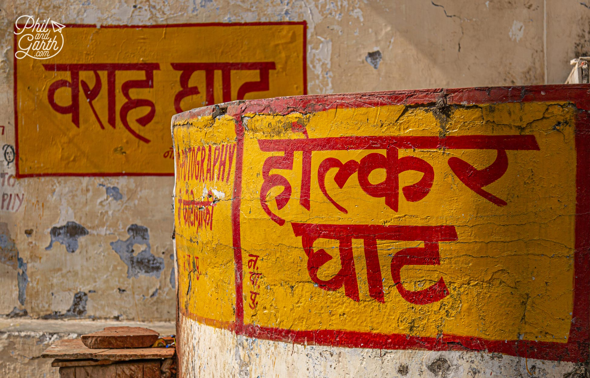 The ghat signs are hand painted in distinctive yellow and red colours