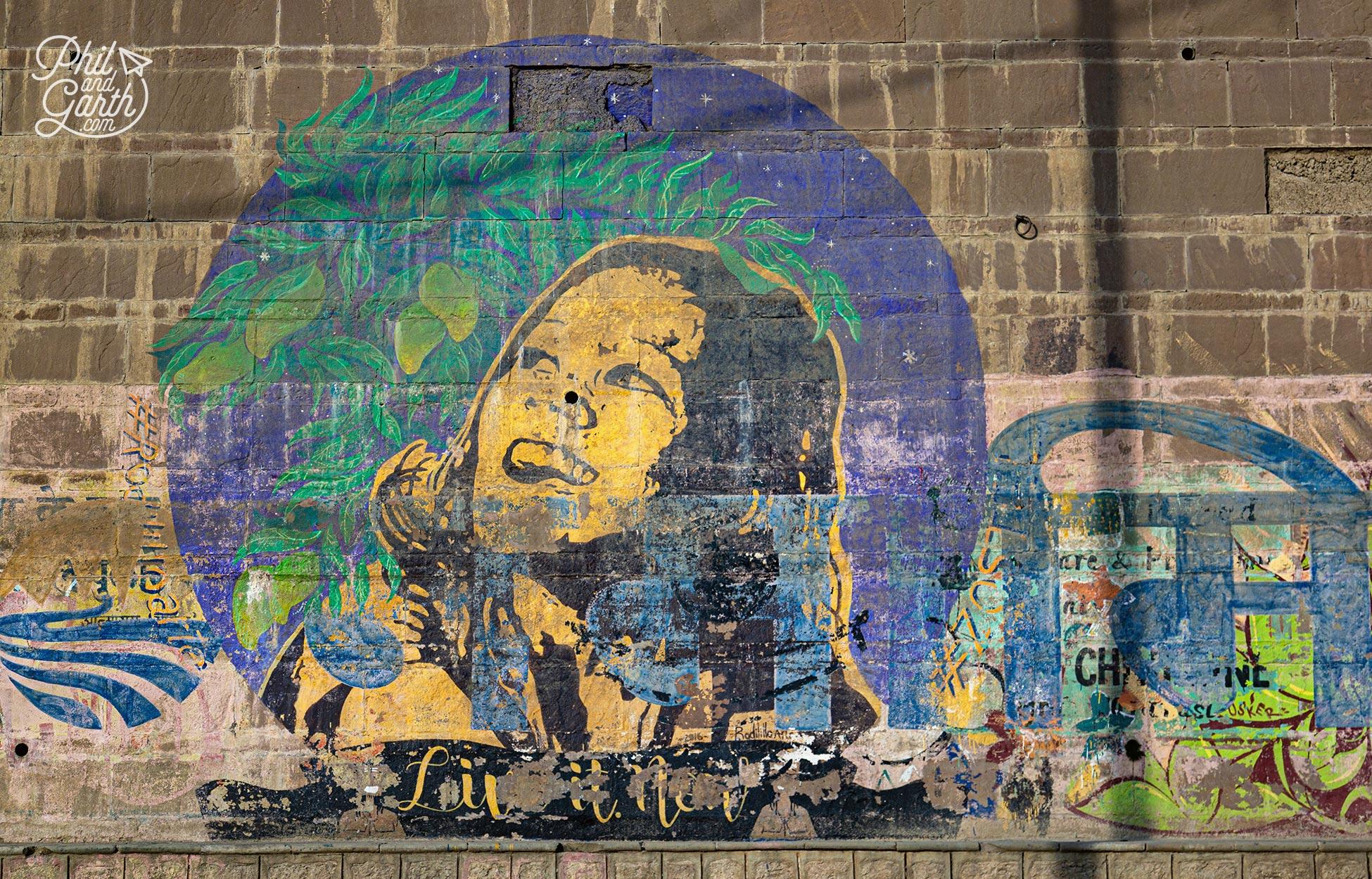 Varanasi street art - looks like this artwork is called Live It Now