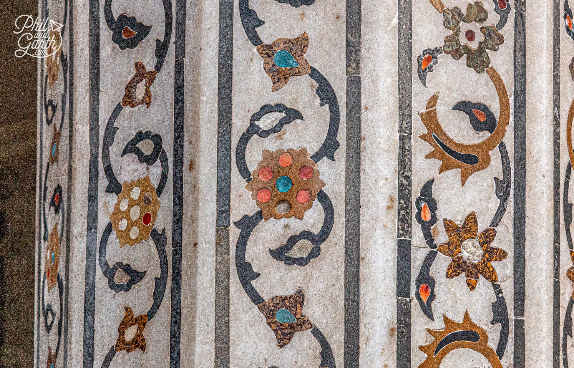 White marble with inlaid precious stones