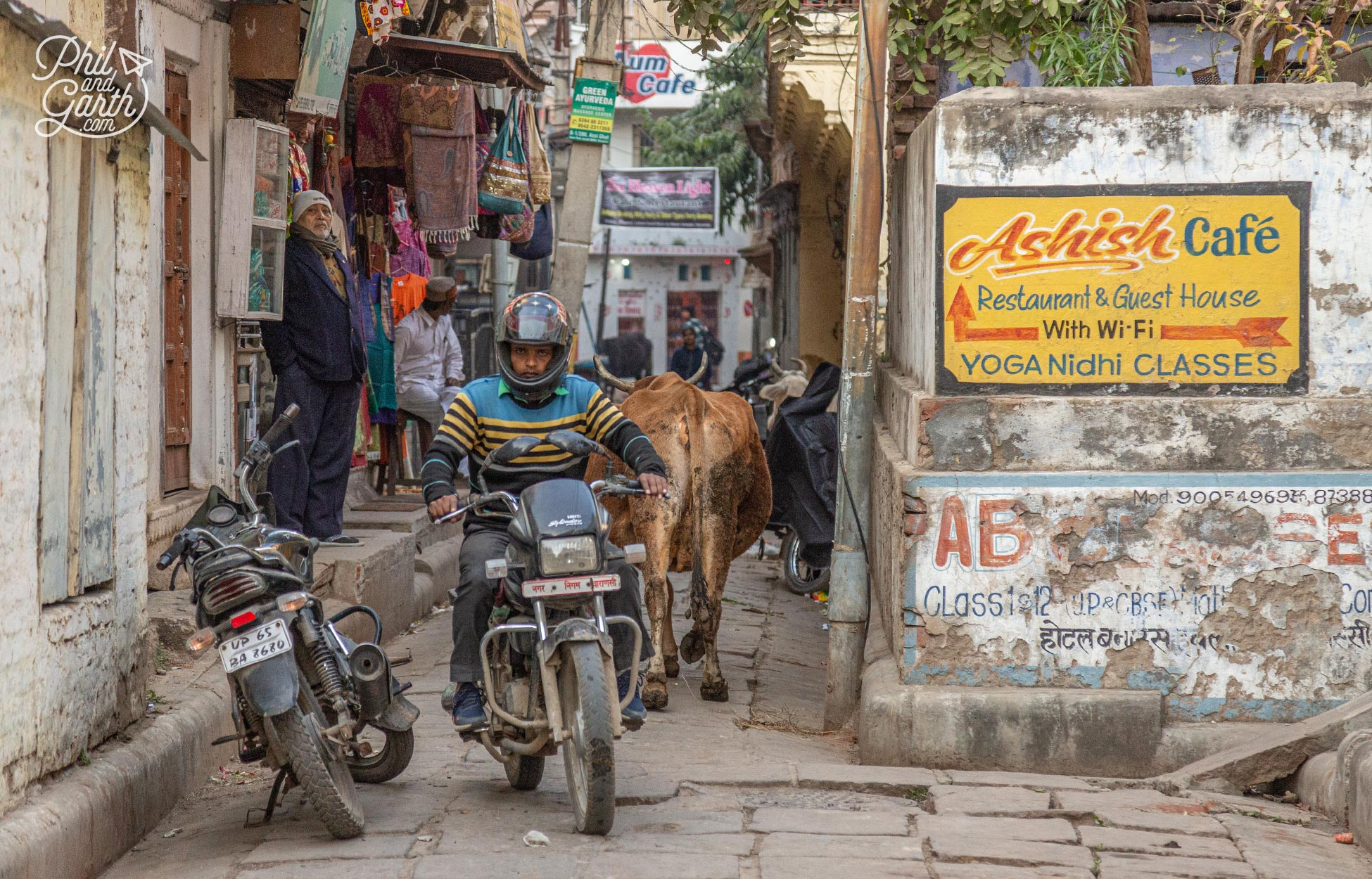 People, motorbikes and holy cows share some of these tiny streets