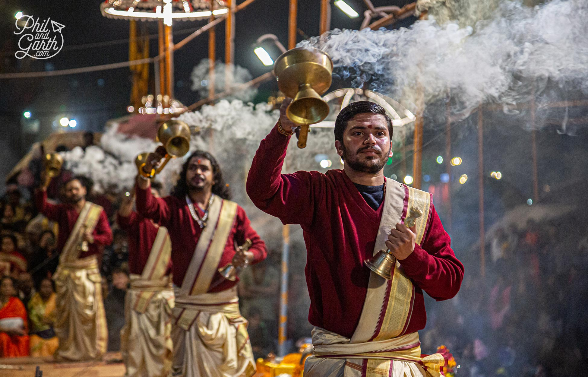 Young monks and priests perform the nightly Ganga Aarti ceremony