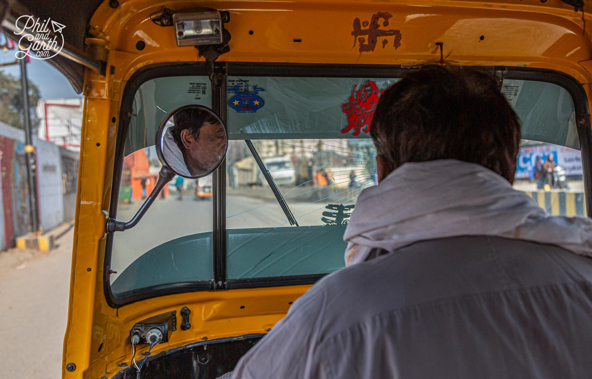 One of our many tuk tuk drivers