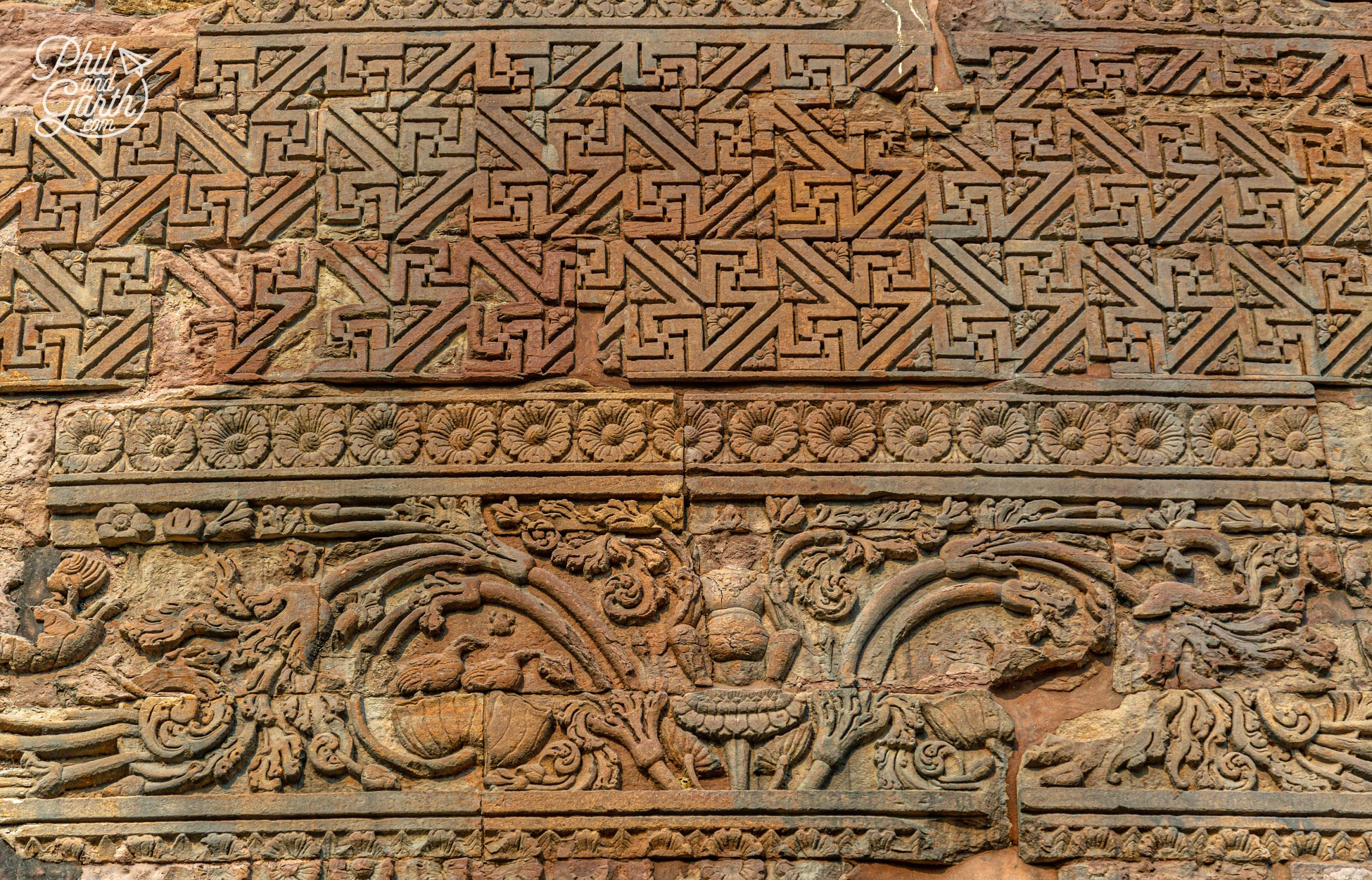 The Dhamek Stupa's carvings include flowers,birds and people
