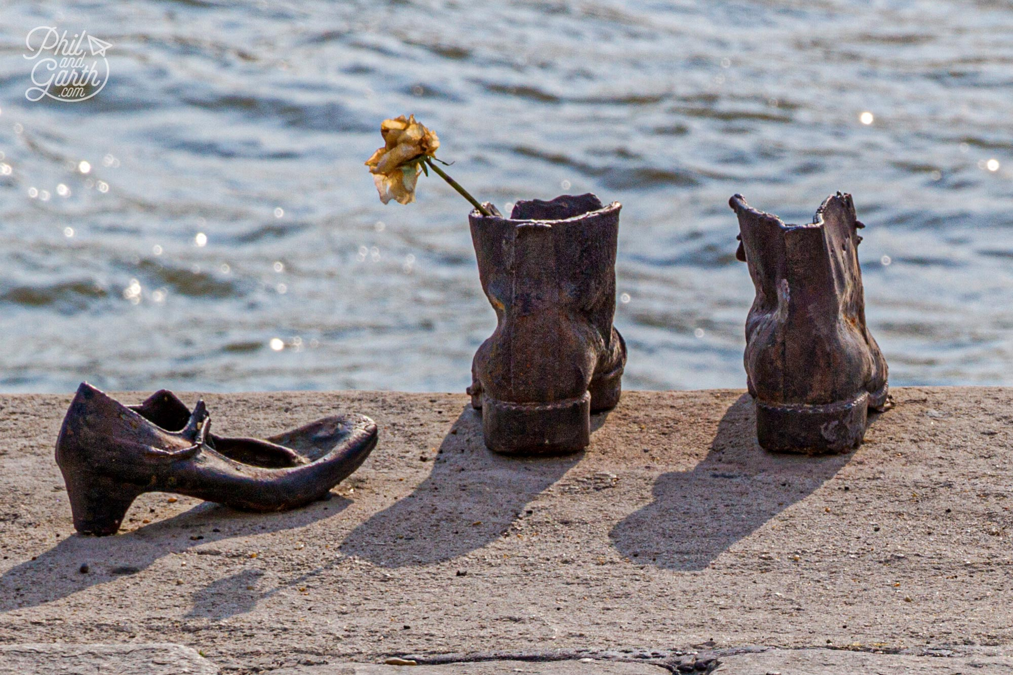 The memorial includes some tiny shoes of a child