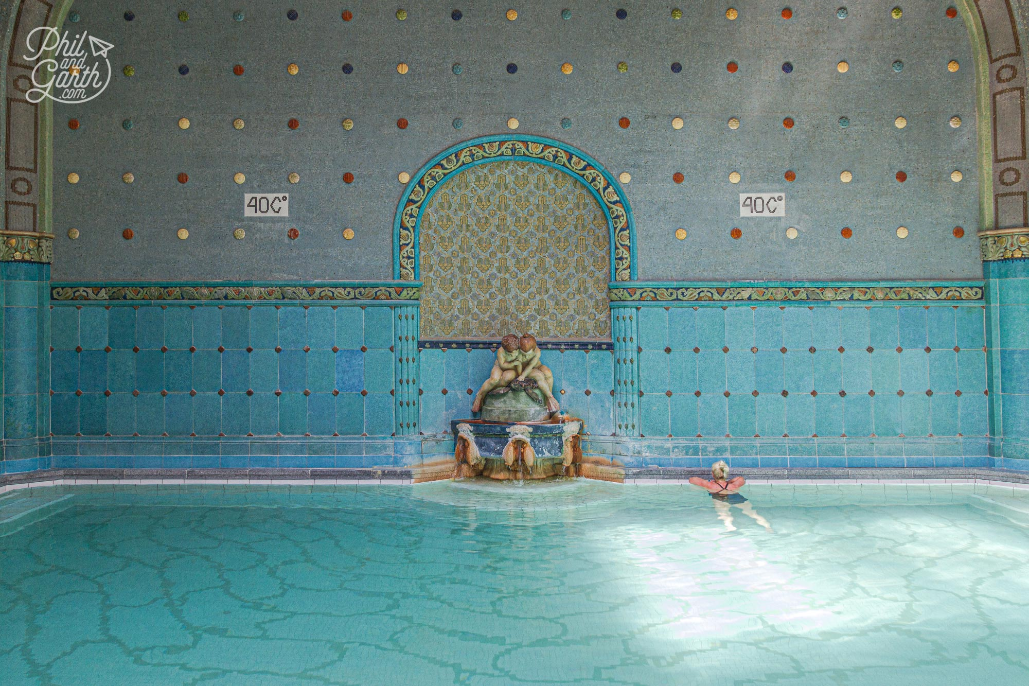 The opulent interior of the hot thermal pool