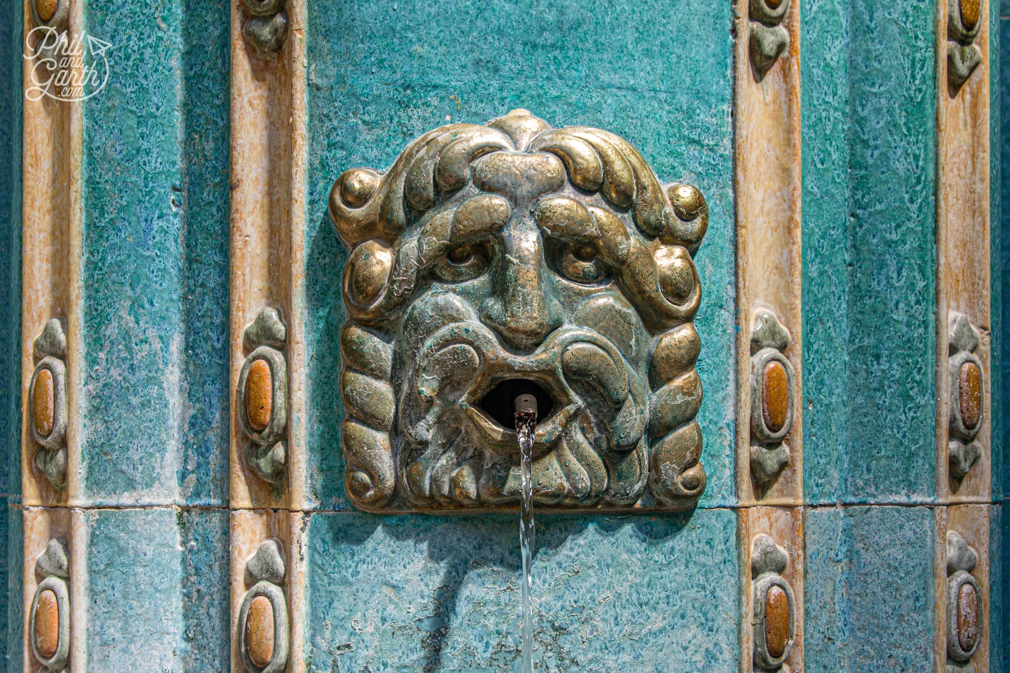 This face serves up hot water in the Gellért Spa