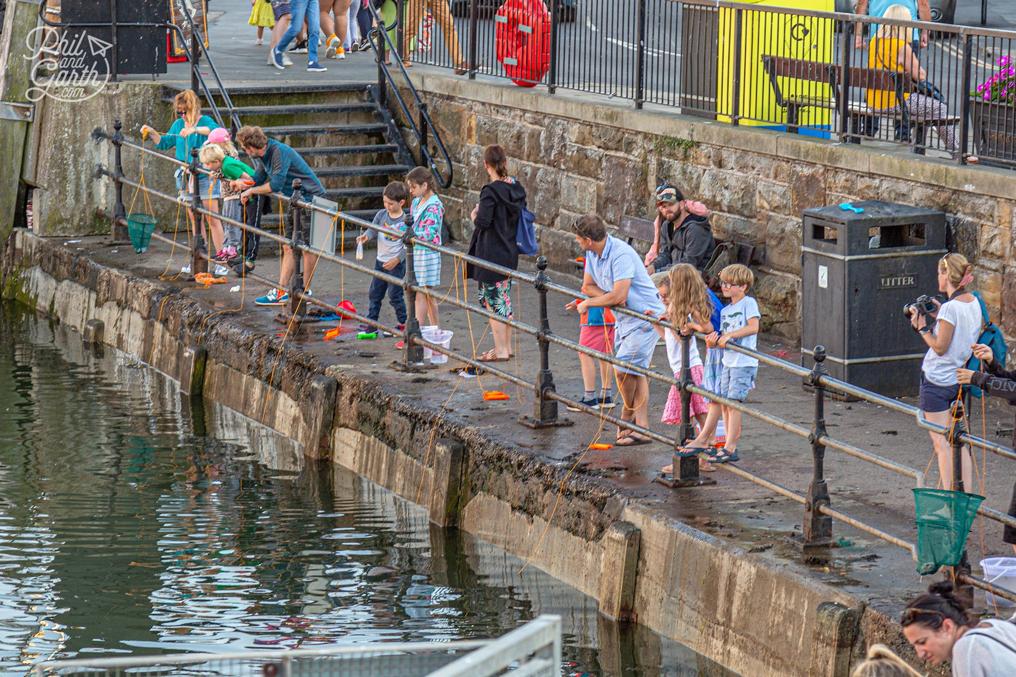 Crabbing in Whitby Harbour - a popular activity for families