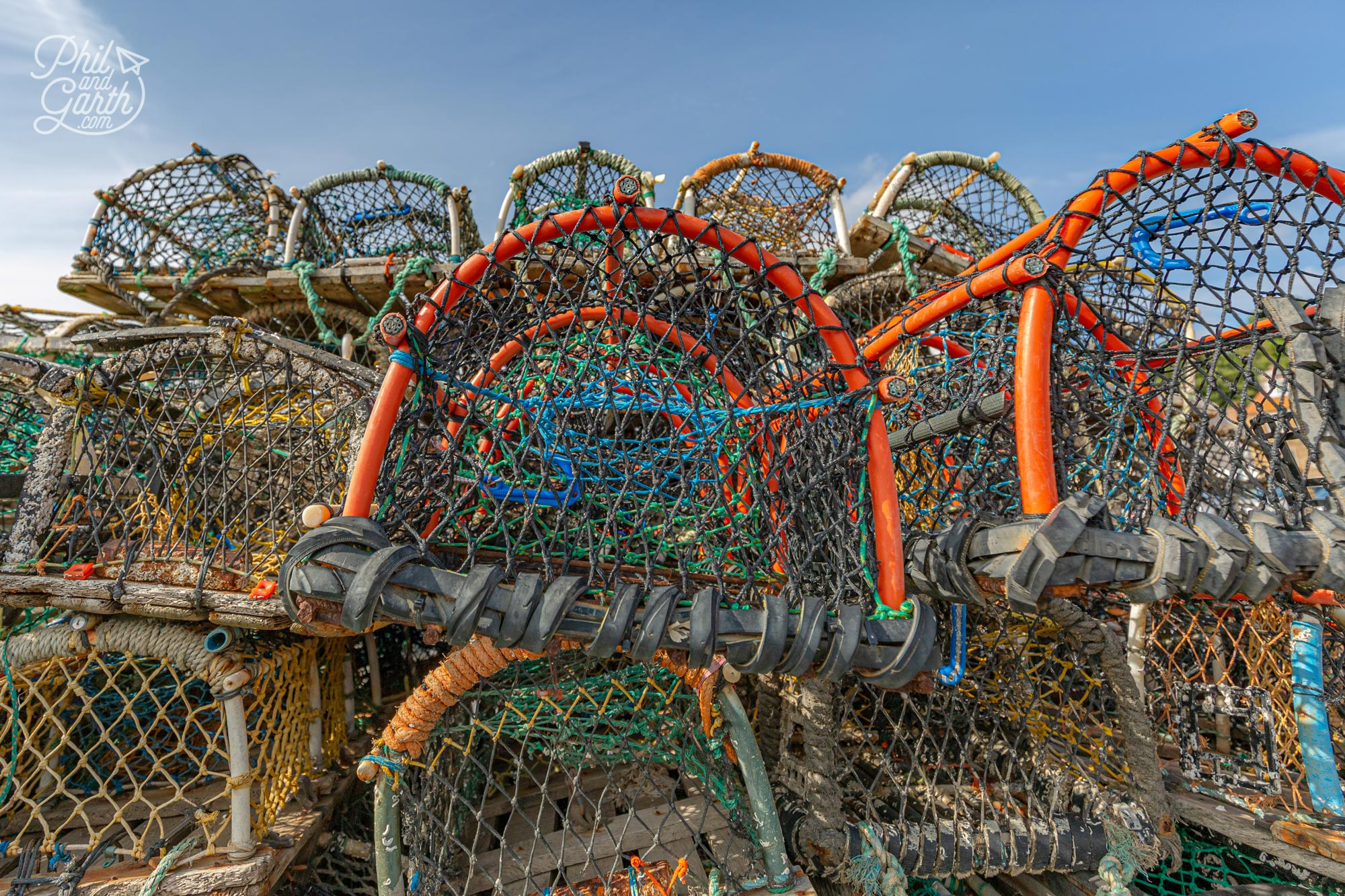 Lobster pots line the harbour, used by fishermen to catch lobsters, crayfish and crabs