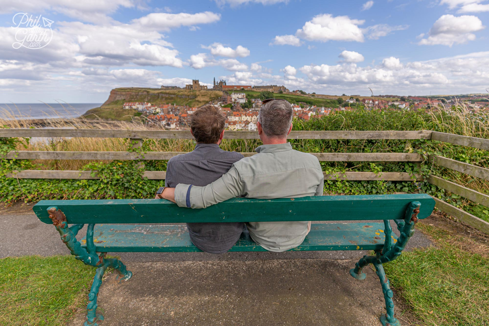 Phil and Garth sat on the Bram Stoker bench looking out to the view of Whitby Abbey that inspired him
