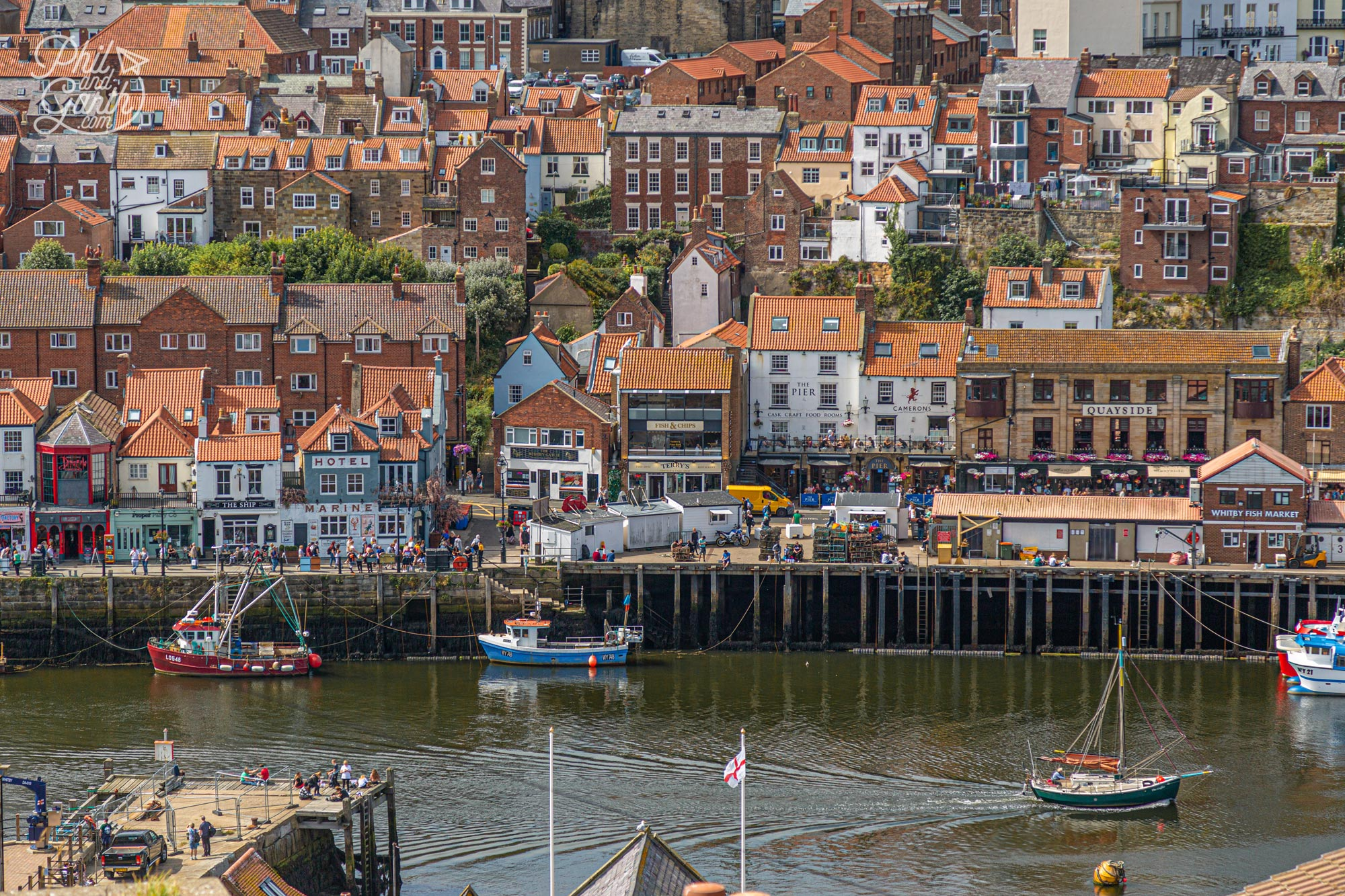 The view from the 199 Steps of Whitby's harbour and red rooftops