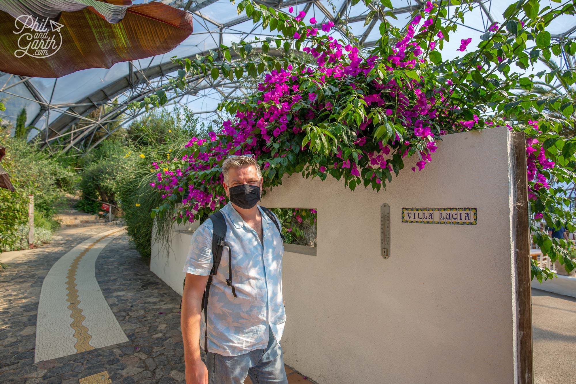 Phil next to the pink bougainvillea at the start of the Mediterranean garden